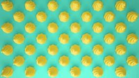 平的五颜六色的流行艺术构成用黄色党杯形蛋糕,面包店好吃的东西,在绿松石背景,仿造纹理拷贝 免版税库存照片