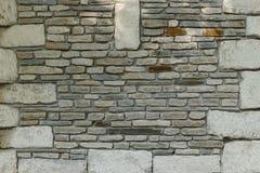 平的石砖和岩石块,墙壁纹理 免版税图库摄影