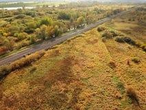 平直的铁路通过秋天风景 图库摄影