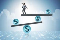 平衡在财政美元概念的商人 库存照片