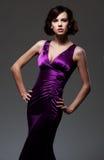 平衡紫罗兰色妇女的礼服 库存图片