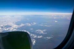 从平面窗口的看法在地球 图库摄影