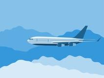 平面飞行通过云彩 免版税图库摄影