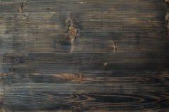 水平黑暗的木纹理的背景 免版税库存图片