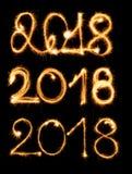 2018年与在黑背景的闪烁发光物 库存图片