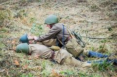 1941年在波多利斯克军事学院的纳粹队伍和军校学生的之间世界大战争斗的重建2 库存图片