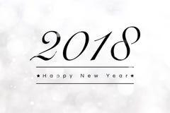 2018年新年快乐在bokeh白色背景的问候文本 图库摄影