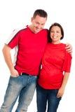 年轻人微笑的怀孕的夫妇 免版税库存图片