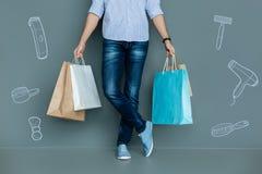 年轻人藏品购买,当去的购物时 免版税库存照片