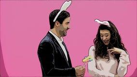 年轻夫妇创造性在桃红色背景 使用在头的兔宝宝耳朵 在此期间,妻子对负装饰 股票录像