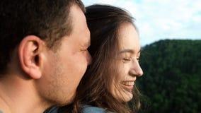 年轻女人在她的男朋友的胳膊愉快地微笑 股票录像