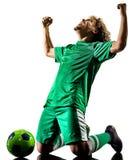 年轻少年足球运动员人剪影隔绝了庆祝 库存照片