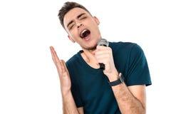 年轻帅哥唱歌卡拉OK演唱传神 库存照片