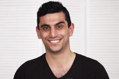 年轻愉快中东人微笑 库存图片