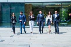 年轻成功的企业队画象在办公室外 图库摄影
