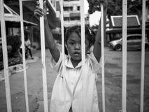 年轻泰国女孩关在监牢里 库存照片