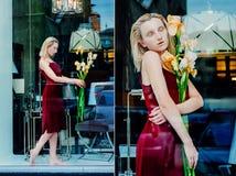 年轻白肤金发的可爱的妇女的画象有虹膜的在玻璃后开花 库存照片