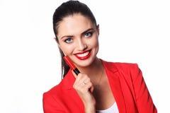 年轻美丽的妇女拿着一支红色唇膏 库存图片