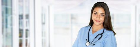 年轻西班牙女性护士 库存图片