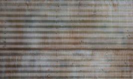 年迈的波纹状的钢金属盘区 免版税图库摄影