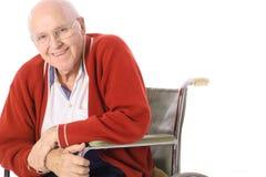 年长愉快的人轮椅 免版税图库摄影
