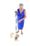 年长的人她的宠物 免版税库存照片