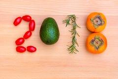 年2018做了蔬菜、草本和水果在木backgro 免版税库存照片
