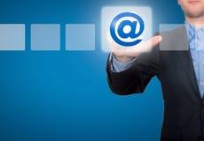 给并且请与在商人前面的标志-储蓄图象联系发电子邮件 库存图片