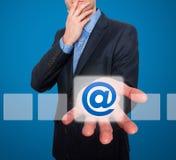 给并且请与在商人前面的标志-储蓄图象联系发电子邮件 免版税图库摄影