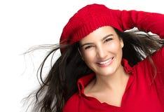 幸福。红色的快乐的冬天女孩。飞行头发 免版税库存照片