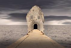 幻想岩石房子在海洋 免版税库存照片