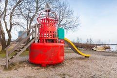 幻灯片由红色浮体制成在公开操场 图库摄影