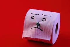 幽默-与面孔的在鼻子的卫生纸和钉 库存图片