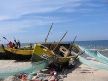 广告小船捕鱼网 图库摄影