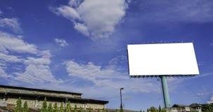 广告有蓝天的广告牌在背景中 免版税库存图片