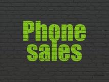 广告概念:在墙壁背景的电话销售 免版税库存图片