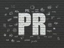 广告概念:在墙壁背景的PR 免版税库存图片