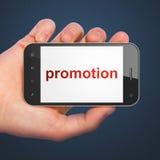 广告概念:在智能手机的促进 免版税库存图片