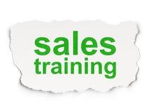 广告概念:在纸背景的销售培训 免版税库存照片
