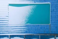 广告牌包括雪 免版税图库摄影