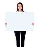 广告牌空白女实业家白种人藏品 免版税库存照片