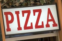 广告薄饼餐馆takeway符号的街道 免版税库存照片
