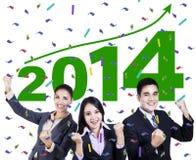 庆祝一个新年的激动的商人2014年 免版税图库摄影