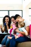 庆祝一个婴孩第一个生日的三名妇女 库存照片