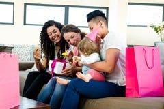 庆祝一个婴孩第一个生日的三名妇女 库存图片