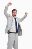 庆祝与他的胳膊的生意人 免版税库存照片