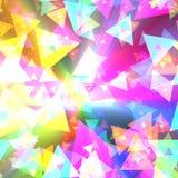 庆祝五颜六色的五彩纸屑发光的三角 库存图片