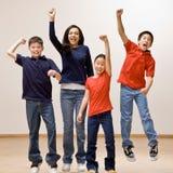 庆祝他们欢呼的儿童的成功 库存照片