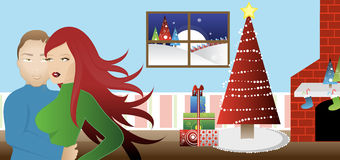 庆祝圣诞节夫妇 免版税库存照片