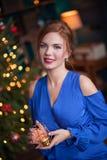 庆祝圣诞节妇女 库存照片